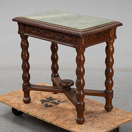 An early 20th century oak side table with a stone top.
