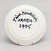 Tiina nordström, a porcelain decorative plate, signed tiina nordström arabia 1995.