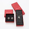 Georg jensen heritage silver a pair of earrings and a necklace.