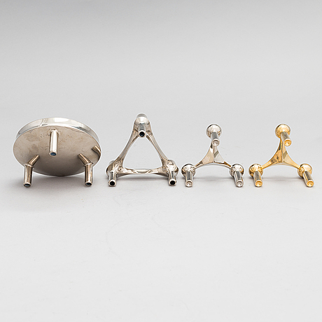An 8 + 1 piece metal candle holder by ceasar stoffic & fritz nagel, germany, second half of the 20th century.