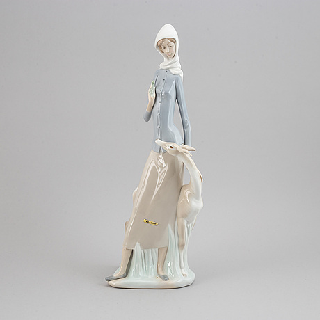 A lladro porcelain figure of a lady with a dog, spain, 20th century.