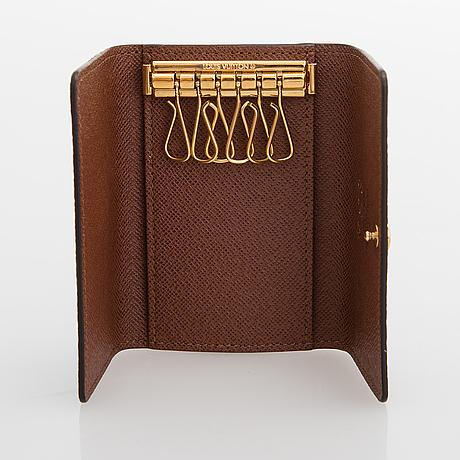 """Louis vuitton, """"victorine"""", plånbok samt 6 nycklars fodral."""