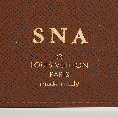 """Louis vuitton, """"victorine"""" lompakko sekä 6 avaimen avainkotelo."""