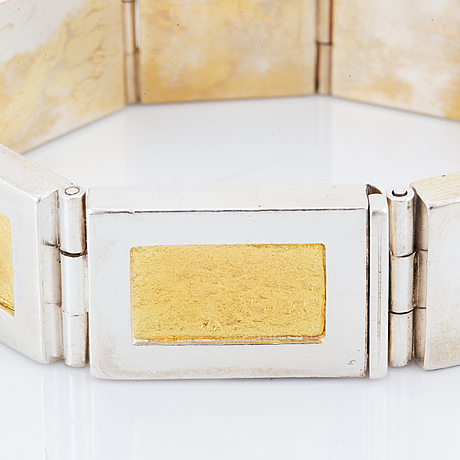 A michael hamma bracelet in silver and 18k gold.