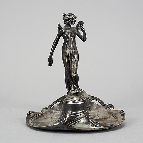 An early 20th century art nouveau metal ink well.