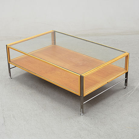 A glass top coffee table, late 20th century.