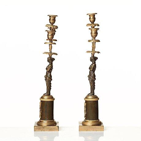 A pair of late gustavian circa 1800 three-light candelabra.