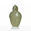 A chinese carved nephrite snuff bottle with cover.