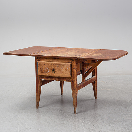 A 19th century table with drop leaves.