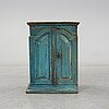 A 19th century painted cabinet.