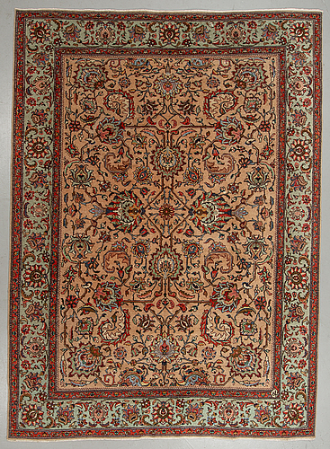 A carpet, old tabriz, ca 328,5 x 239 cm.