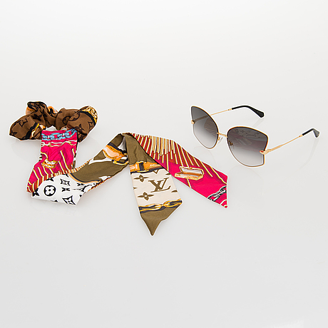 "Louis vuitton, ""les amants du pont neuf"" solglasögon samt ett chouchou hårband."