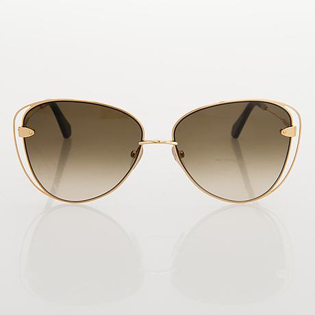 Louis vuitton, 'À nous deux' sunglasses and a chouchou scrunchie.