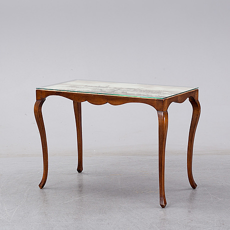 A table with ceramic tiles, dated 1942.