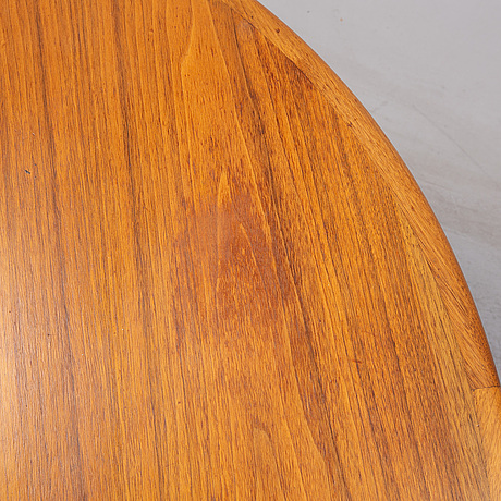 A 1960's walnut dining table with two additional leaves.