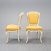A pair of rococo style armchairs and a pair of chairs, circa 1900.