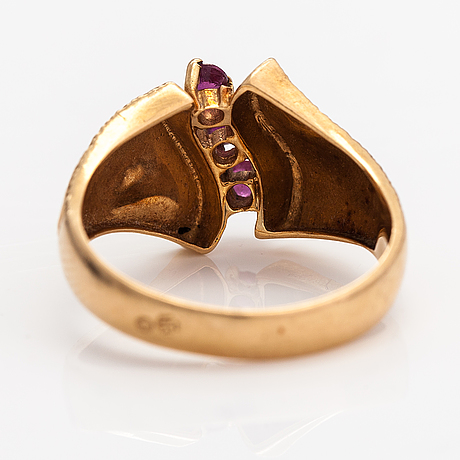 A 14-18k gold ring with rubies.
