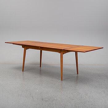 Hans J Wegner, a teak dining table, Andreas Tuck, Denmark.