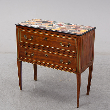 An early 19th century mahogany veneered chest of drawers. pietra dura top signed and dated orlardi aristide roma 1902.