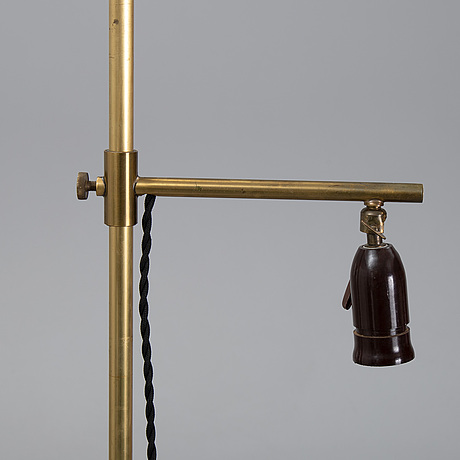 A late 20th century brass floor light.
