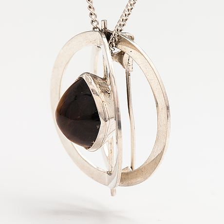 Elis kauppi, a silver necklace/brooch with a tiger's eye. kupittaan kulta, turku 1961.
