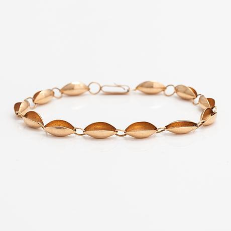 A 14k gold bracelet. siro koru, turku.