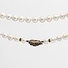 Pearl necklace cultured freshwater pearls, clasp 18>k gold, silver w red-brown stone amd rose-cuts.