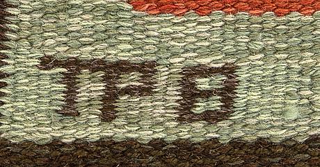 A swedish signed flat weave carpet by textil ateljé polly björkman ca 248 x 176 cm.