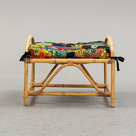 An armchair with ottoman, bamboo and rattan, second half of the 20th century.