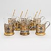 A set of eight kubachi tea glass holders and five teaspoons, parcel-gilt silver, niello, russia 1960s.