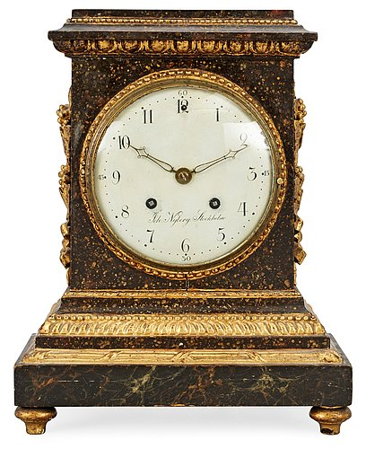 A late gustavian wooden mantel clock by j. nyberg.