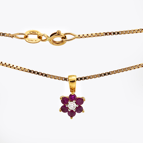Pendant and chain 18k gold 1 brilliant-cut diamond and rubies, 4,3 g, length approx 50 cm.