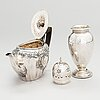 A sterling silver teapot and sugar caster, england 1900 and 1924.