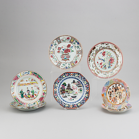 Five famille rose plates, and a pair of japanese dishes. qing dynasty and japan, 18th and 20th century.
