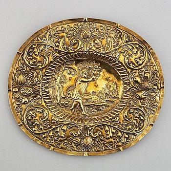 A North European brass dish, 17th-/18th century.