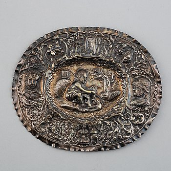 A North European silvered copper dish, 19th century.