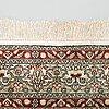 A silk carpet. circa 188x125 cm.