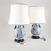 A pair of chinese blue and white vases, turned into table lamps, modern.