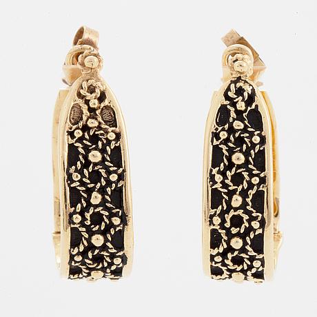 14k gold hoop earrings.