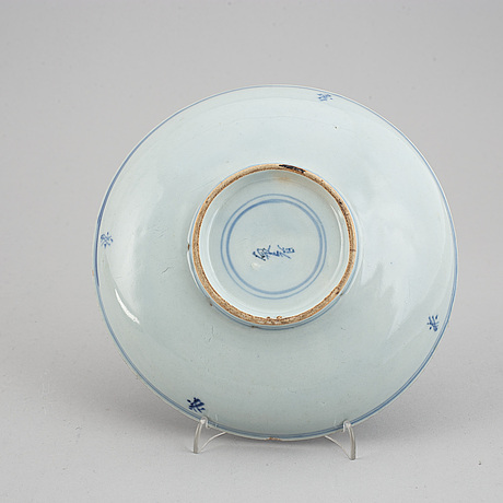 A blue and white serving dish and a japanese dish, qing dynasty, 18th and 19th century.