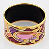 Frey wille, an enamel and gilt metal bangle, 'hommage à alphonse mucha'.