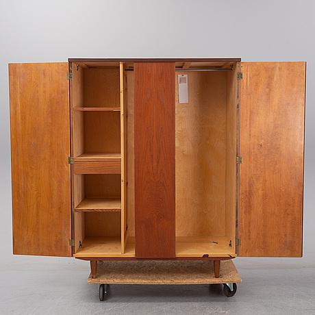 A 1960's danish teak wardrobe.