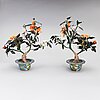 A pair of chinese table decorations in various stones, enamelled pots. the latter half of the 20th century.