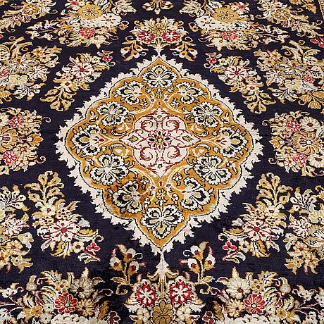 A carpet, old silk qum, ca 261 x 156 cm.