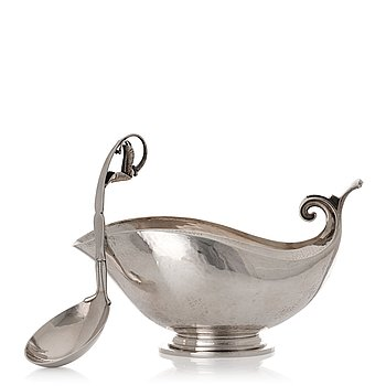 155. Georg Jensen, a sterling silver sauceboat and ladle, Copenhagen 1925-1945, design nr 98 and 141.