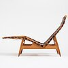 Arne vodder, a teak chaise longue with black leather straps, bovirke denmark 1950's.