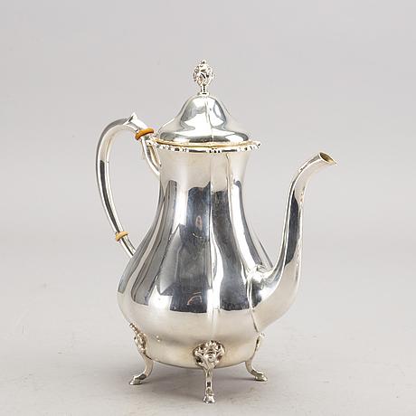 A three pieces silver coffee set.