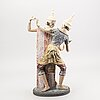 A stonewear figurine from lladro.