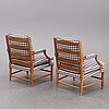 An end of the 20th century pair of gustavian style oak armchairs.
