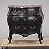 A mid 20th century rococo style chest of drawers.